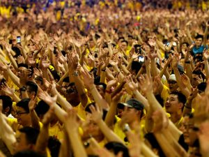 Protesters raise their hands as they gather near the Dataran Merdeka during a rally organised by electoral reform group Bersih 2.0, to demand for institutional reforms, the freedom to protest, measures to save the economy and a clean government and political system, in Kuala Lumpur on August 29, 2015. The Malaysian Insider/Najjua Zulkefli